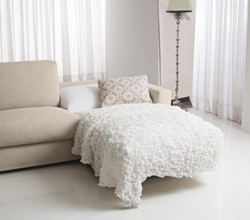 Dettaglio penisola divano letto beige